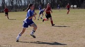 Kayla playing soccer when she was younger