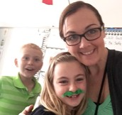 Mrs. Warner and two of her green Patriots!
