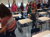 Participating in the Literary Term Relay in Mrs. Sutton's and Mrs. Quartier's Blue 7 ELA class