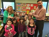 Mr. Garrepy and Kindergarten showing off the new chicks