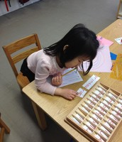 Sylvia is using the Small Moveable Alphabet to build words to describe  her picture.