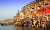 People bathing off of the ghats