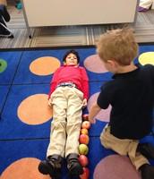 Dexter is measuring Baasel's height