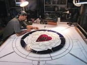 A stained glass artist in action