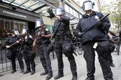 """Gear police wear at even a peaceful protest (""""Police overkill has become the default American policy - Salon.com"""")"""
