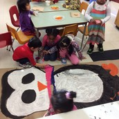 Working together on a special decoration for our classroom door