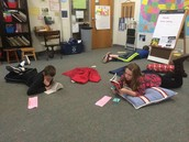 5th graders checking out Book Club selections