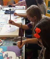 Students busy painting at 4Cats Art Studio in Kent, Ohio.