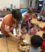 Lauren and Amy help the kids make applesauce