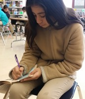 Ms. Guy's 5th grade student Rosa Stop and Jots during Reading Group time