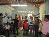 Church group receiving doctrinal teaching and books from Khoa.