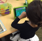 Kinder students learn about coding