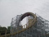 Roller coaster cart going over loop on Hades 360.