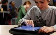 kid in school using tablets