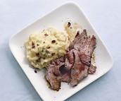 Rib Eye Steak with loaded potatoes