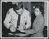 Rosa Parks with an officer