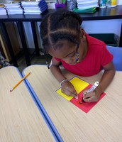 Raadiya creating her booklet