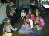 Mr. Pape reading to a group of kids.