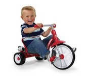 Baby riding a tricycle