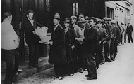 Unemployed men line up for work