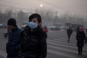 A person in Beijing wearing a protective mask