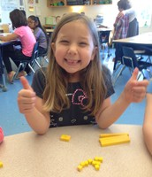 Lillie made the number four using unit place value blocks.