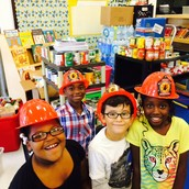 Ms. Smith's first grade poses in front of their stash.