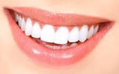 Examines and treats diseases and injuries of teeth and gums.
