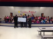 $4500.00 Donation from Kia of Huntsville
