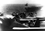 "Japanese Navy Type 99 Carrier Bombers (""Val"") prepare to take off from an aircraft carrier during the morning of 7 December 1941. Ship in the background is the carrier Soryu."