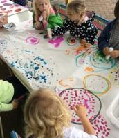 Amelia, Juliette, Kate, Arlo creating One Dot Mural