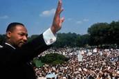 MLK Waves as Crowd Applauds