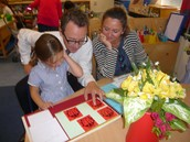 Isabella shows her mummy and daddy her ladybird maths