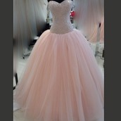Peach colored not too poofy sweetheart neckline.