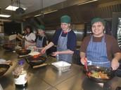 Enrichment students making Chicken Stir Fry