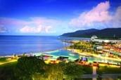Why should I visit Cairns?