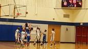 8th grade boys' basketball action