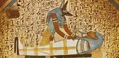 Anubis with a Pharoah in a sarcophagus