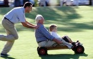 A grandpa playing with his grandson