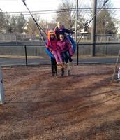 The girls swinging high