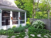 Screen Porch with flagstone patio