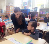 Ana checking in with a student.