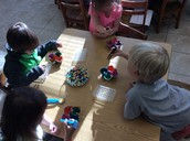 Friends working hard at the fine motor table!