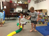 Helping our friends on the Gross Motor track during indoor Recess.