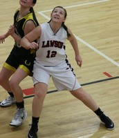 Carley Chancellor boxes out a Lathrop Lady Mule in the Lawson JV Tournament