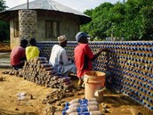 Building an Earthship style hut using plastic bottles