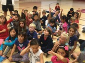 2nd graders feverishly ask questions of our guest