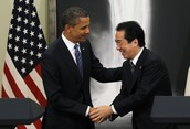 Obama shakes hands with Japanese Prime Minister Naoto Kan