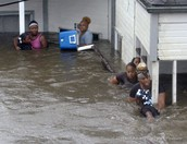 THIS A PICTURE OF A FAMLIY ANS KIDS IN HURRICANE KATRINA