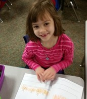 Working on writing in her writing journal!